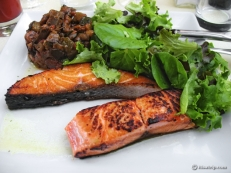 Grilled salmon with ratatouille and salad leaves